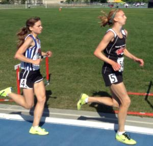 Mirelle Martens (5) and Nicole Kitt (4) in the late stages of the Junior 3000m at 2014 AA Outdoor Championships