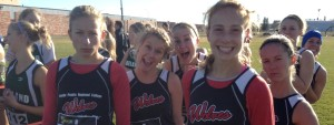 Wolves Women put on a game face before the start of the 2014 ACAC XC Running Championships in Ft McMurray