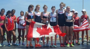 Mirelle Martens (2nd from the left) and her Team Canada teammates captured the gold medal at the PanAmerican Cup XC Running Champs on Feb. 22.  (Photo from Athletics Canada)
