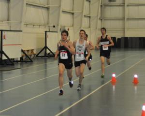 Hayden Hollowell (leading) placed second in the 3000m at the 2015 AA Age Group Indoor Provincials