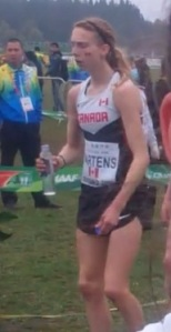 An exhausted Mirelle Martens at the end of the Junior Women's race at the 2015 World Cross Country Running Championships