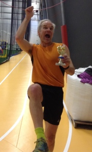 Excited athlete enjoying his Rick Scott Open trophy