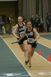 Janai Martens hands the baton to Maria Houle in the 4 x 400m relay at the 2017 Golden Bear Challenge. The Wolves team placed third in the race.